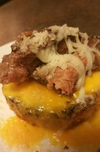 Keto English muffin with melted cheeses and steak