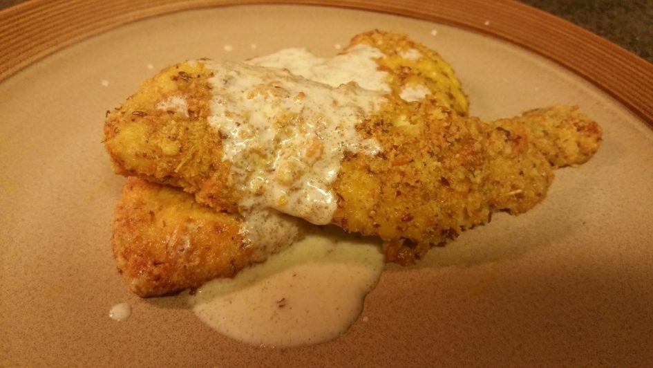 Low carb keto parmesan crusted baked chicken with white wine lemon butter sauce