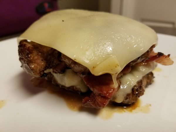 Keto/Low-Carb Bunless Bacon Double Cheeseburger made with Extra sharp White Cheddar cheese