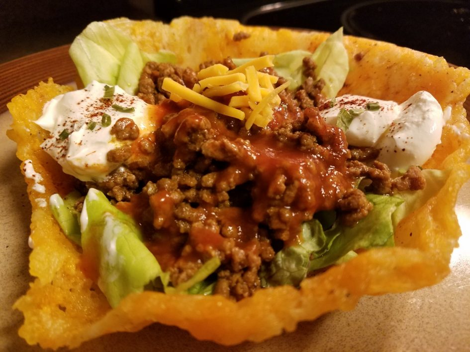 Keto low carb taco bowl made out of shredded cheddar cheese