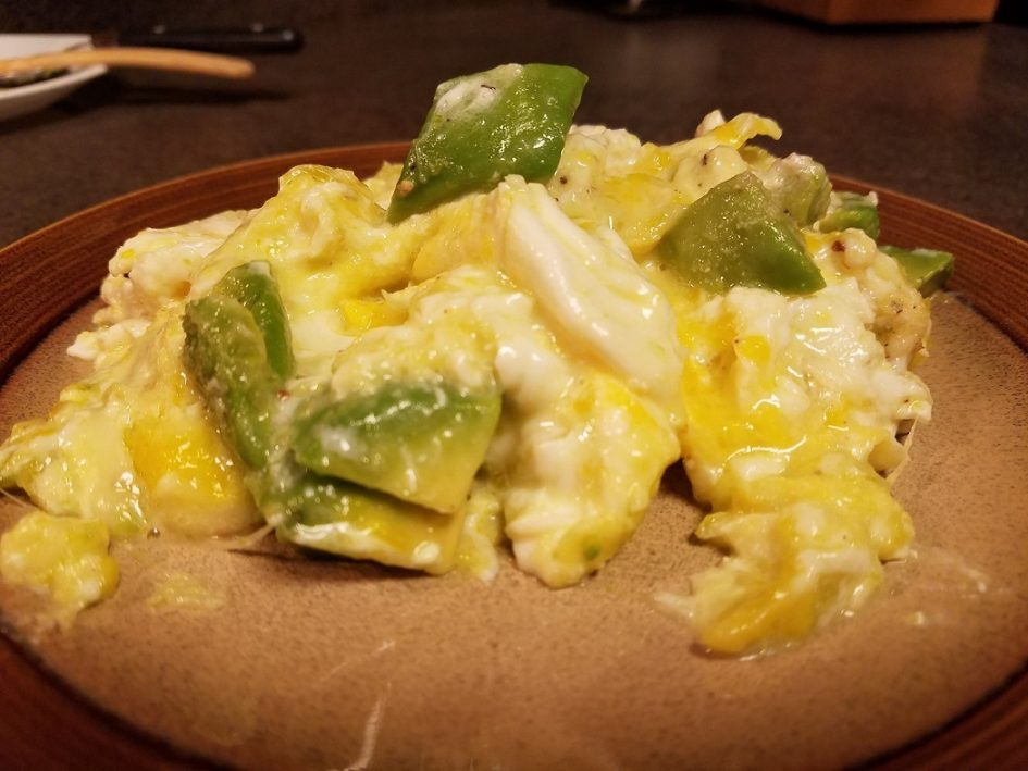 Soft scrambled eggs with avocado and cheese